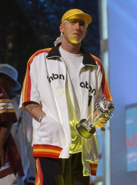 Eminem holding Moonman award