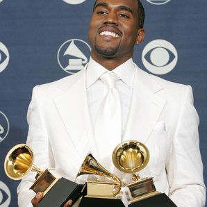 Kanye West holding Grammy Awards