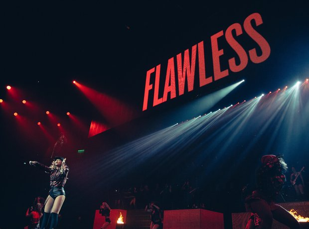 Beyonce performs in front of Flawless sign on Mrs Carter Show Tour