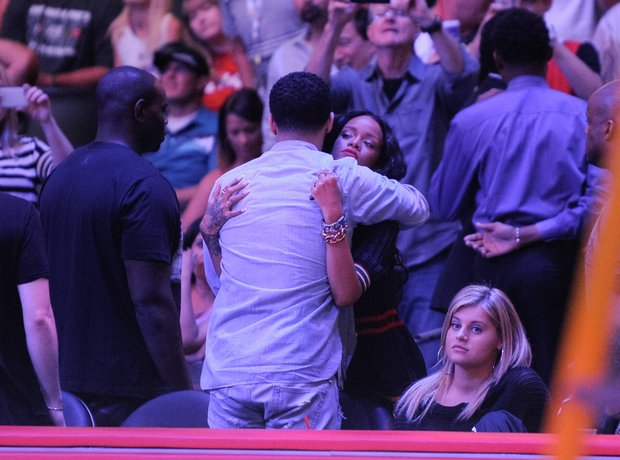 Rihanna and Drake hug at the basketball in Los Angeles
