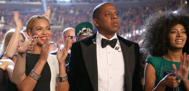Beyonce Jay Z and Solange clapping