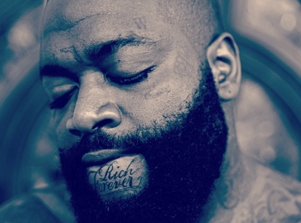 Rick Ross Rich Forever tattoo on chin