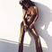 Image 7: Rihanna gold jumpsuit Harpers Bazaar