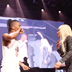 Nicki Minaj with fan On stage