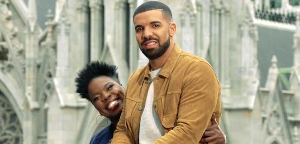 Drake sitting on Leslie Jones' lap.