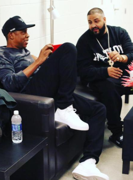 Jay Z DJ and Khaled sitting on chair