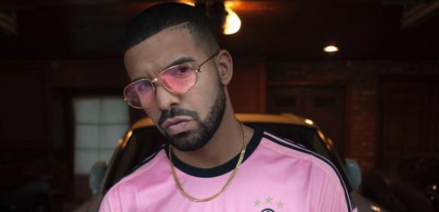 Drake wearing football Shirt