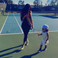 Image 10: Kim Kardashian and North West playing tennis.